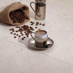 Shell-Beige-16×16-Brushed-Tile-with-Coffee-Closeby