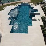 Shell-Beige-Backyard-Poolside-Paver-Project-12×24-24×48