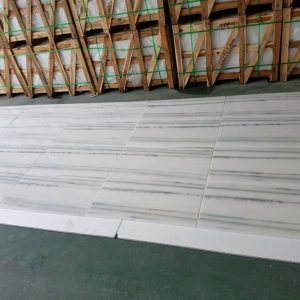 Bianco Vena 7 Bianco Vena 12x24 Marble Tile closeby with Crates Pic